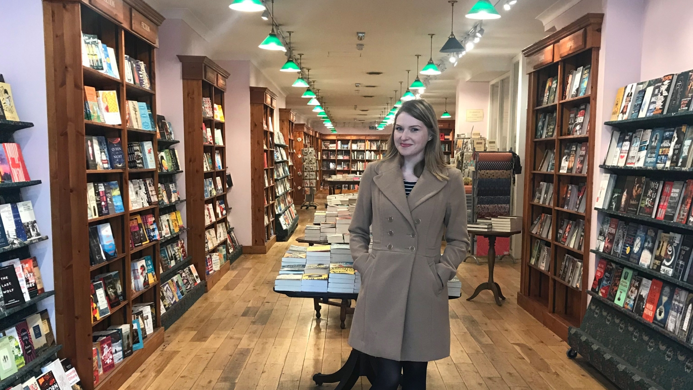 Cat the blogger in a bookshop