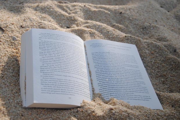 book lying open on a beach