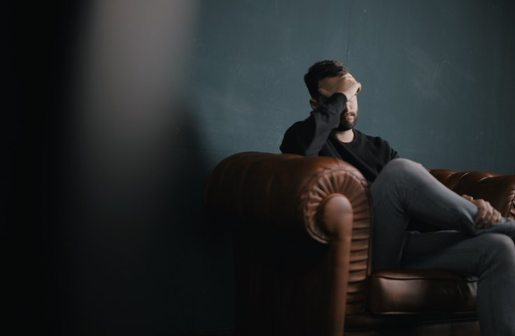 Man sitting on a therapists' couch