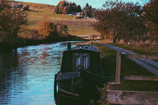 Canal boat on canal in English countryside