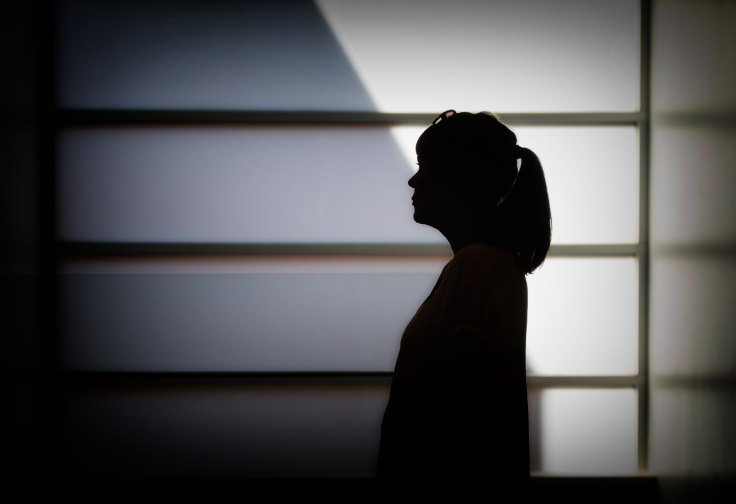 Silhouette of woman against a wall