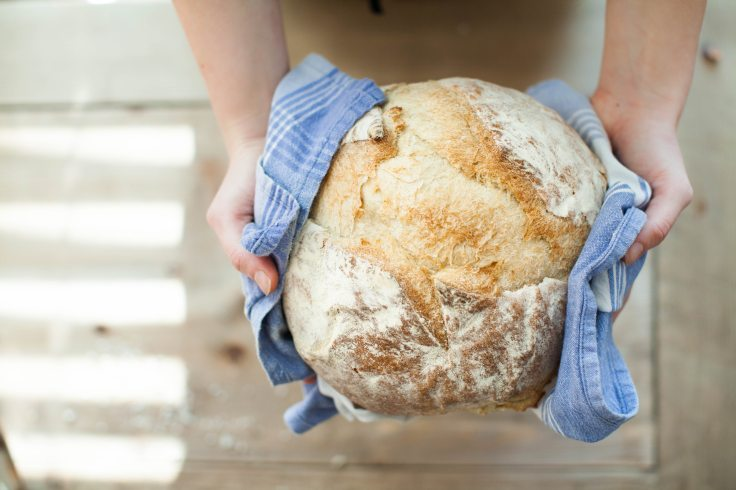 Woman holding bread loaf