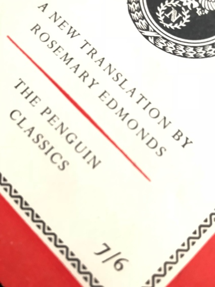 Close up view of old fashioned pricing on book cover