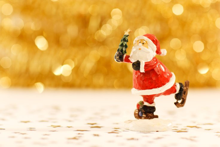 Skating Christmas Santa Figurine