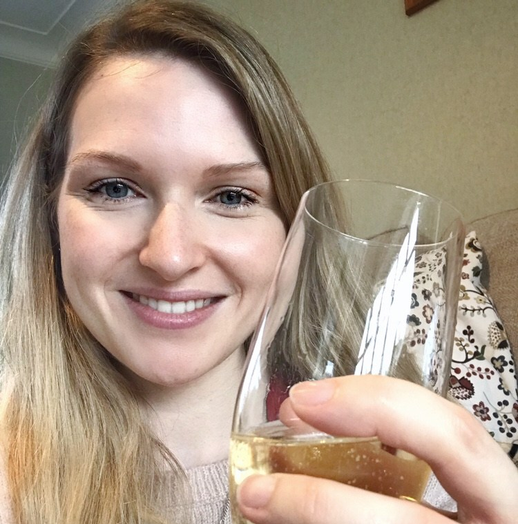 author with a glass of champagne